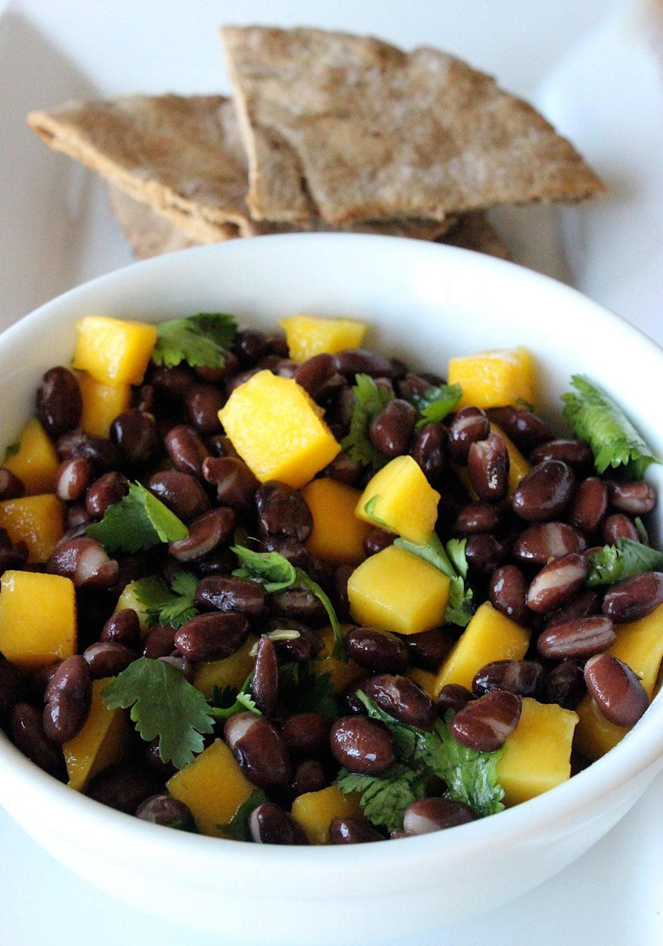 """<p>With more than 13 grams of fiber and nearly 17 grams of protein, this light, clean, and potassium-rich dish will refuel your body after a tough workout, help you rehydrate, and even help soothe sore muscles.</p> <p><strong>Get the recipe:</strong> <a href=""""http://www.popsugar.com/fitness/Healthy-Black-Bean-Salad-34778386/"""" class=""""link rapid-noclick-resp"""" rel=""""nofollow noopener"""" target=""""_blank"""" data-ylk=""""slk:black bean and mango salad"""">black bean and mango salad</a></p>"""