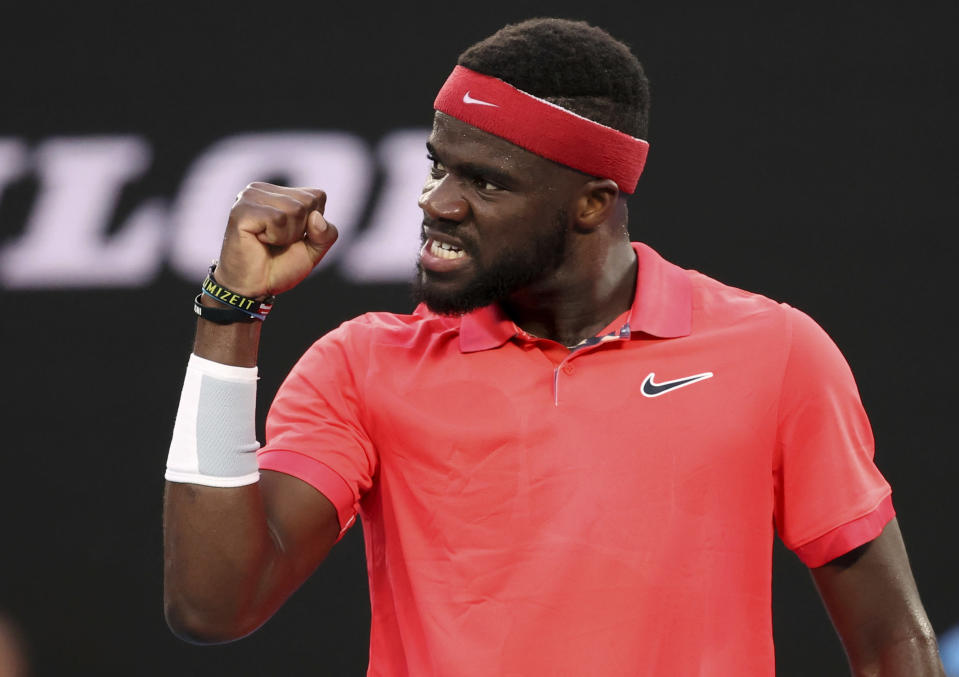 Frances Tiafoe of the U.S. reacts during his first round singles match against Russia's Daniil Medvedev at the Australian Open tennis championship in Melbourne, Australia, Tuesday, Jan. 21, 2020. (AP Photo/Lee Jin-man)