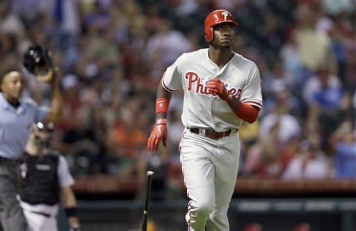 Philadelphia Phillies' Domonic Brown watches his two-run home run during the seventh inning of a baseball game against the Houston Astros on Friday, Sept. 14, 2012, in Houston. (AP Photo/David J. Phillip)