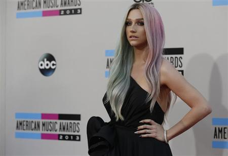 Musician Ke$ha arrives at the 41st American Music Awards in Los Angeles