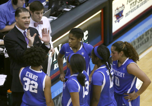 Kentucky head coach Matthew Mitchell, left, talks with his team during the second half of an NCAA college basketball game against DePaul Thursday, Dec. 12, 2013, in Chicago. Kentucky won 96-85. (AP Photo/Charles Rex Arbogast)