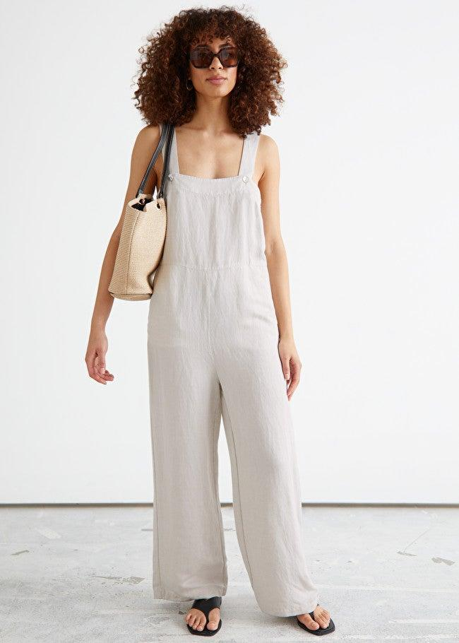 """<em>Shop <strong><a href=""""https://www.stories.com/en_usd/clothing/jumpsuits-playsuits"""" rel=""""nofollow noopener"""" target=""""_blank"""" data-ylk=""""slk:& Other Stories"""" class=""""link rapid-noclick-resp"""">& Other Stories</a></strong></em><br><br><strong>& Other Stories</strong> Relaxed Square Neck Jumpsuit, $, available at <a href=""""https://go.skimresources.com/?id=30283X879131&url=https%3A%2F%2Fwww.stories.com%2Fen_usd%2Fclothing%2Fjumpsuits-playsuits%2Fproduct.relaxed-square-neck-jumpsuit-white.0969972001.html"""" rel=""""nofollow noopener"""" target=""""_blank"""" data-ylk=""""slk:& Other Stories"""" class=""""link rapid-noclick-resp"""">& Other Stories</a>"""