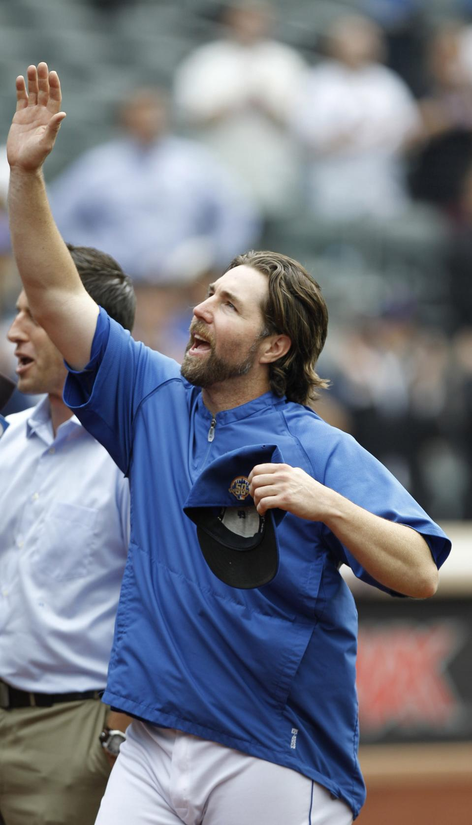 New York Mets starting pitcher R.A. Dickey acknowledges fans as he celebrates his 20th victory of the season after the Mets 6-5 win against the Pittsburgh Pirates in a baseball game at Citi Field in New York, Thursday, Sept. 27, 2012. (AP Photo/Kathy Willens)