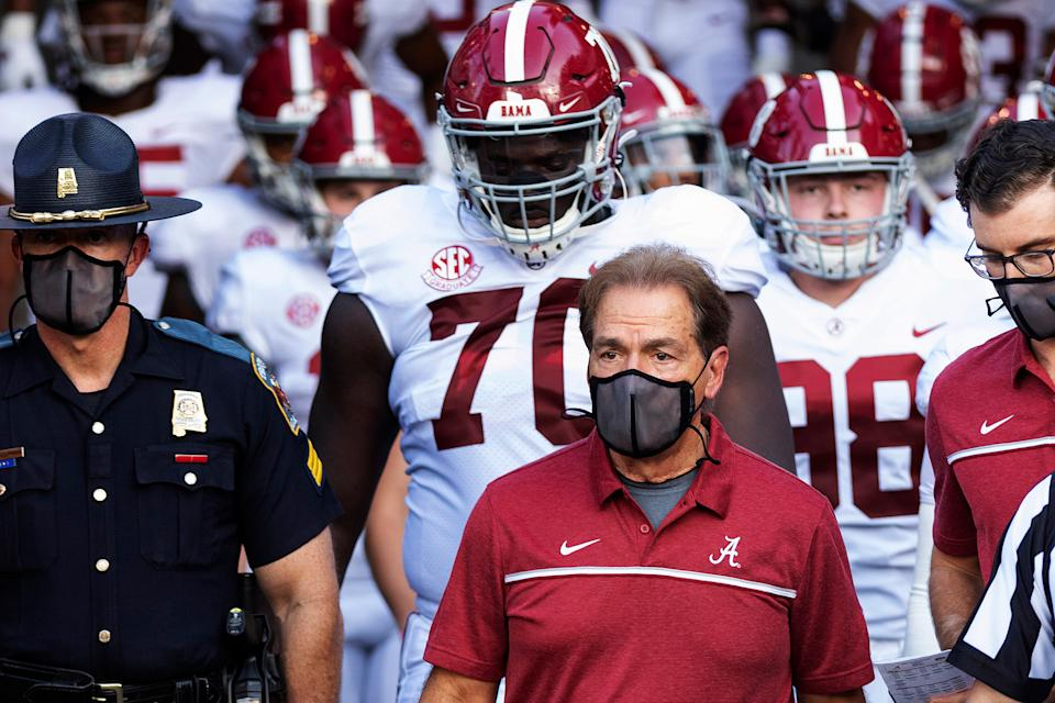 "Alabama coach Nick Saban leads his team to the field before an NCAA college football game against Missouri in Columbia, Mo., on Sept. 26, 2020. Saban and athletic director Greg Byrne tested positive for COVID-19, days before the Southeastern Conference's biggest regular-season showdown.<span class=""copyright"">L.G. Patterson—AP</span>"