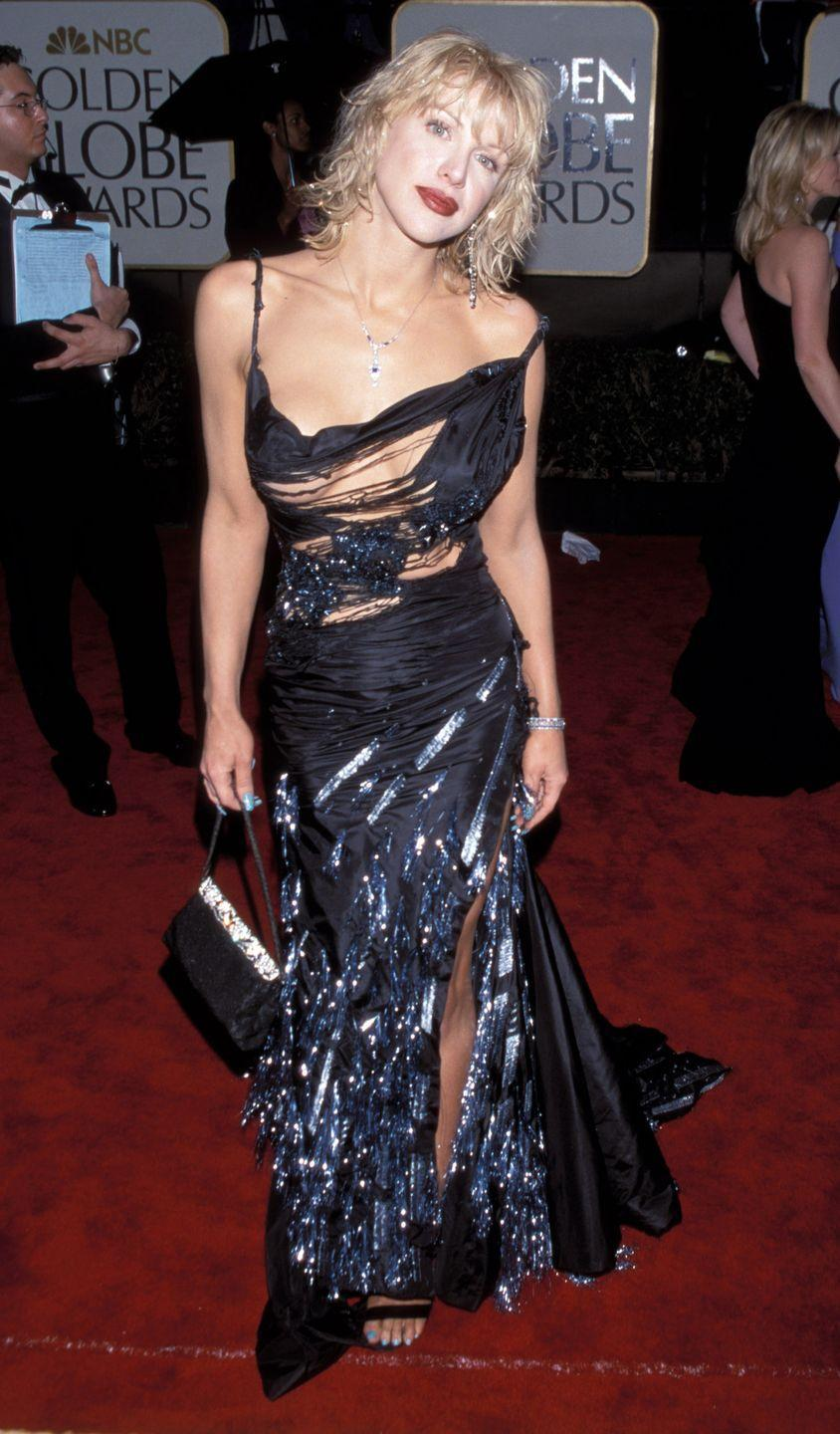 """<p>Courtney Love wore this <a href=""""https://www.theguardian.com/fashion/2019/apr/02/courtney-love-i-thought-this-dress-is-crazy-looking-but-ill-make-it-work"""" rel=""""nofollow noopener"""" target=""""_blank"""" data-ylk=""""slk:semi-shredded dress"""" class=""""link rapid-noclick-resp"""">semi-shredded dress</a> by John Galliano to the 2000 Golden Globes. It was controversial largely because it was part of a couture collection that was <a href=""""https://wwd.com/fashion-news/fashion-features/moment-87-homeless-by-dior-3346959/"""" rel=""""nofollow noopener"""" target=""""_blank"""" data-ylk=""""slk:&quot;inspired&quot; by Paris' homeless population"""" class=""""link rapid-noclick-resp"""">""""inspired"""" by Paris' homeless population</a>, which some felt was insensitive to those who actually experience homelessness. </p>"""