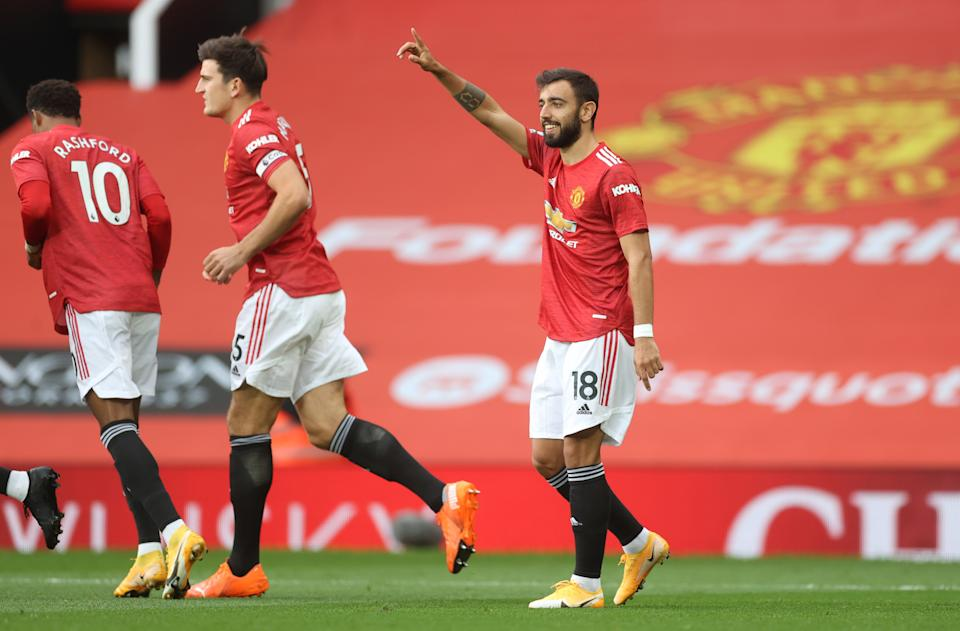 MANCHESTER, ENGLAND - OCTOBER 04: Bruno Fernandes of Manchester United celebrates after scoring his sides first goal during the Premier League match between Manchester United and Tottenham Hotspur at Old Trafford on October 04, 2020 in Manchester, England. Sporting stadiums around the UK remain under strict restrictions due to the Coronavirus Pandemic as Government social distancing laws prohibit fans inside venues resulting in games being played behind closed doors. (Photo by Carl Recine - Pool/Getty Images)