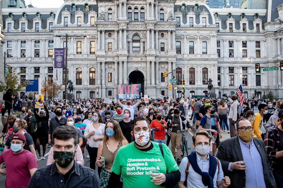 People celebrate outside Philadelphia City Hall after Joe Biden was declared winner of the 2020 presidential election. (Photo by Chris McGrath/Getty Images)
