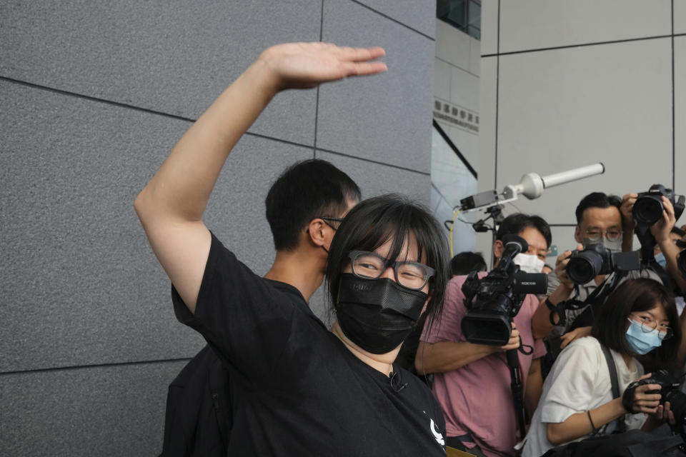 Chow Han Tung, vice chairwoman of the Hong Kong Alliance in Support of Patriotic Democratic Movements of China, waves to her supporters before delivering a letter to the police to reject their information request at the police headquarters in Hong Kong, Tuesday, Sept. 7, 2021. The group said the Hong Kong government is arbitrarily labeling pro-democracy organizations as foreign agents so they can be prosecuted under a tough national security law, Tuesday. (AP Photo/Kin Cheung)