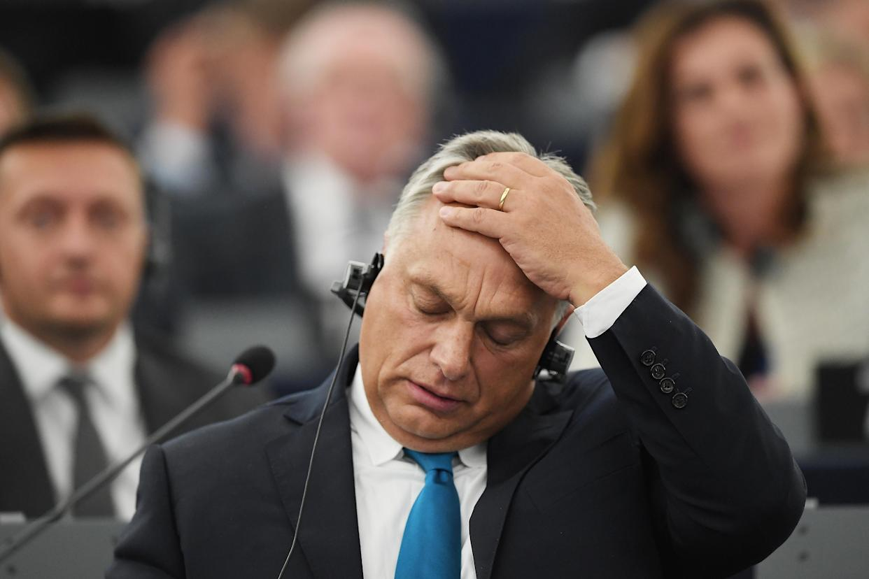 Hungarian prime minister Viktor Orban during a debate with MEPs on Tuesday (AFP)