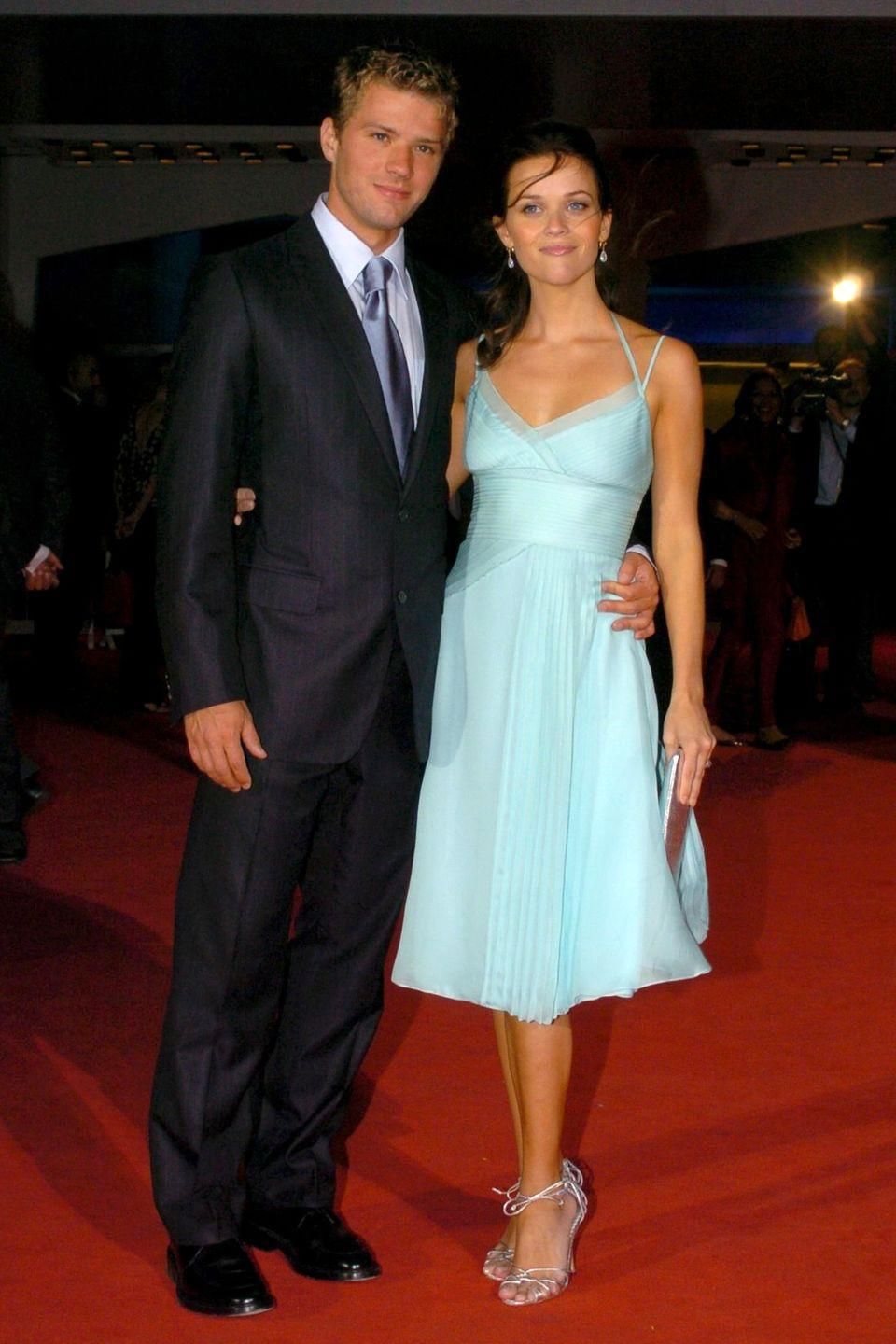 <p>Surprising us with some more color, Witherspoon went for a seafoam midi dress at the Venice Film Festival. </p>