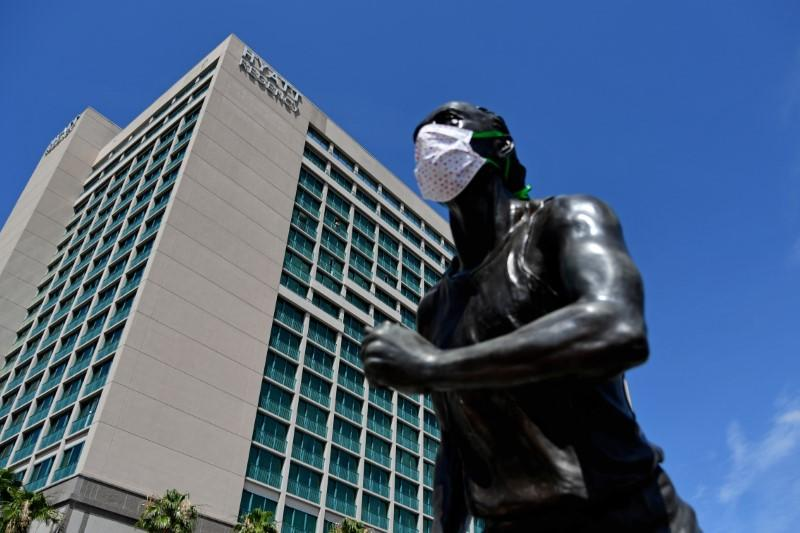 A general view of  astatue with protective masks on outside of the Hyatt Regency the host hotel for UFC 249 at VyStar Veterans Memorial Arena