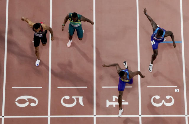 Christian Coleman, of the United States, crosses the finish line to win the men's 100 meter final ahead of silver medalist Justin Gatlin, also of the United States, during the World Athletics Championships in Doha, Qatar, Saturday, Sept. 28, 2019. (AP Photo/Morry Gash)