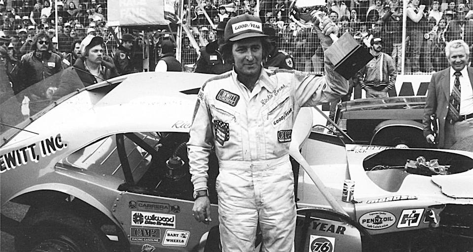 MARTINSVILLE, VA - 1981: Although his car is a bit the worse for wear, NASCAR Modified driver Richie Evans raises another trophy after an obviously hard-fought victory over Geoff Bodine in the most spectacular bump-and-grind finish at the track. (Photo by ISC Images & Archives via Getty Images)