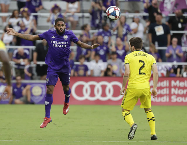 Orlando City's Ruan, left, heads the ball past Columbus Crew's Luis Argudo (2) during the first half of an MLS soccer match Saturday, July 13, 2019, in Orlando, Fla. (AP Photo/John Raoux)