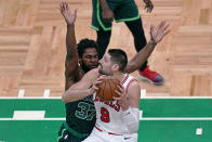 Chicago Bulls center Nikola Vucevic, right, drives to the basket against Boston Celtics forward Semi Ojeleye, left, during the first half of an NBA basketball game, Monday, April 19, 2021, in Boston. (AP Photo/Charles Krupa)
