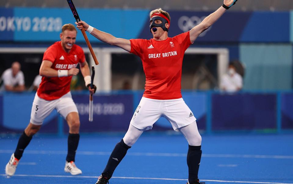 Sam Ward of Britain celebrates after scoring their first goal. - REUTERS