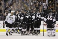 Dallas Stars' Trevor Daley, left, skates past the Los Angeles Kings after an NHL hockey game in Los Angeles, Sunday, April 21, 2013. The Kings won 4-3 in overtime. (AP Photo/Jae C. Hong)