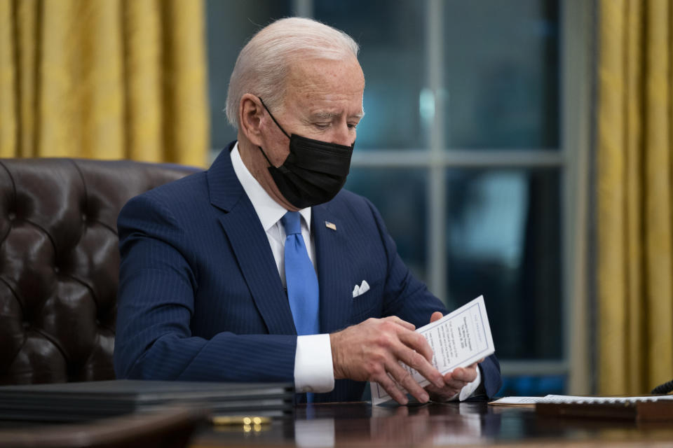 FILE - In this Feb. 2, 2021, file photo President Joe Biden delivers remarks on immigration, in the Oval Office of the White House in Washington. (AP Photo/Evan Vucci, File)