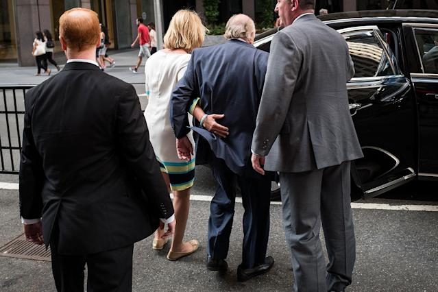 <p>Fox News chairman Roger Ailes is helped to his car by his wife, Elizabeth, as they leave the News Corp. building, July 19, 2016, in New York. (Photo: Drew Angerer/Getty Images) </p>