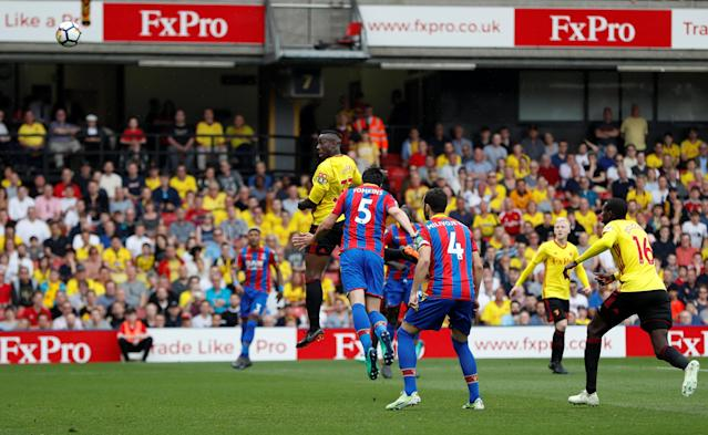 """Soccer Football - Premier League - Watford v Crystal Palace - Vicarage Road, Watford, Britain - April 21, 2018 Watford's Stefano Okaka heads at goal Action Images via Reuters/Paul Childs EDITORIAL USE ONLY. No use with unauthorized audio, video, data, fixture lists, club/league logos or """"live"""" services. Online in-match use limited to 75 images, no video emulation. No use in betting, games or single club/league/player publications. Please contact your account representative for further details."""