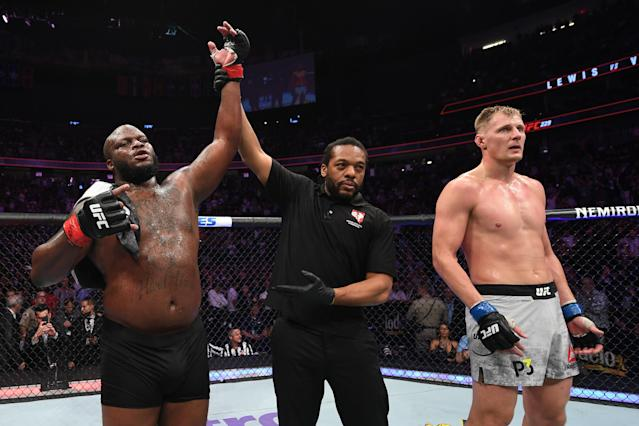 Derrick Lewis raises his hand in victory over Alexander Volkov of Russia in their heavyweight bout during the UFC 229 event inside T-Mobile Arena on Oct. 6, 2018 in Las Vegas, Nevada. (Getty Images)
