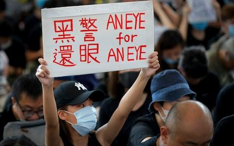 Hong Kong police said 5,000 people were at the airport protest - Credit: Vincent Thian/AP