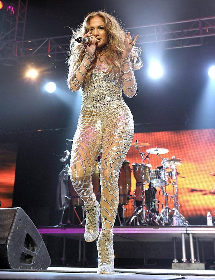 "Jennifer Lopez is another star with a fabulous physique, but it was hard to tell under the glittering spiderweb-like catsuit she wore while performing in Los Angeles. Do you think the outdated look was hot ... or not? John Shearer/<a href=""http://www.wireimage.com"" target=""new"">WireImage.com</a> - May 14, 2011"