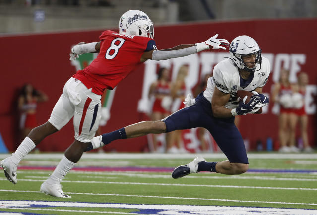 Utah State tight end Caleb Repp catches a pass as Fresno State safety Chris Coleman defends during the first half of an NCAA college football game in Fresno, Calif., Saturday, Nov. 9, 2019. (AP Photo/Gary Kazanjian)