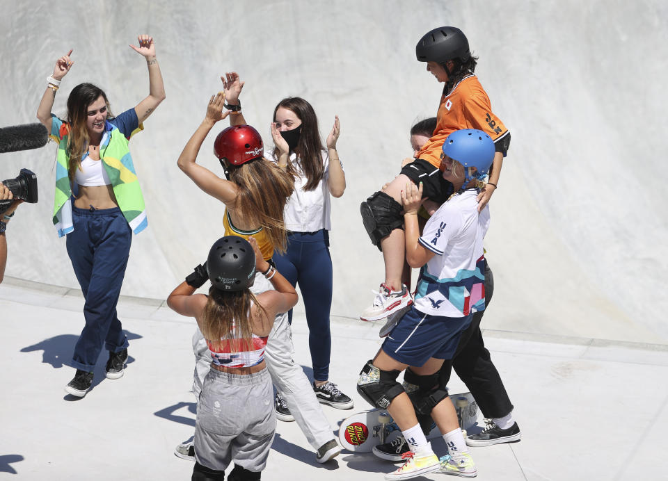TOKYO, JAPAN - AUGUST 4: Misugu Okamoto of Japan is carried by her friends comptetiors during the Women's Park Skateboarding Final on day twelve of the Tokyo 2020 Olympic Games at Ariake Urban Sports Park on August 4, 2021 in Tokyo, Japan.  (Photo by Jean Catuffe/Getty Images)