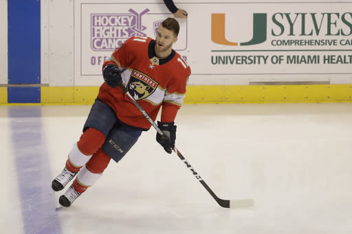 Florida Panthers left wing Jonathan Huberdeau warms up before the start of an NHL hockey game against the Calgary Flames, Sunday, March 1, 2020, in Sunrise, Fla. (AP Photo/Wilfredo Lee)