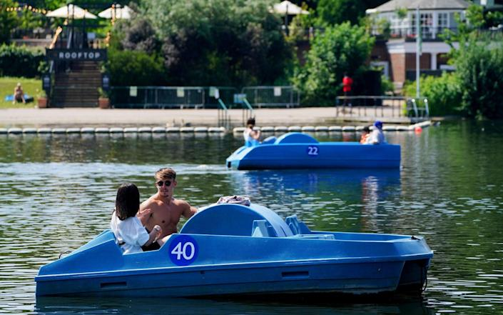 Pedalo riders travel along the Serpentine, in London's Hyde Park - Jonathan Brady/PA Wire