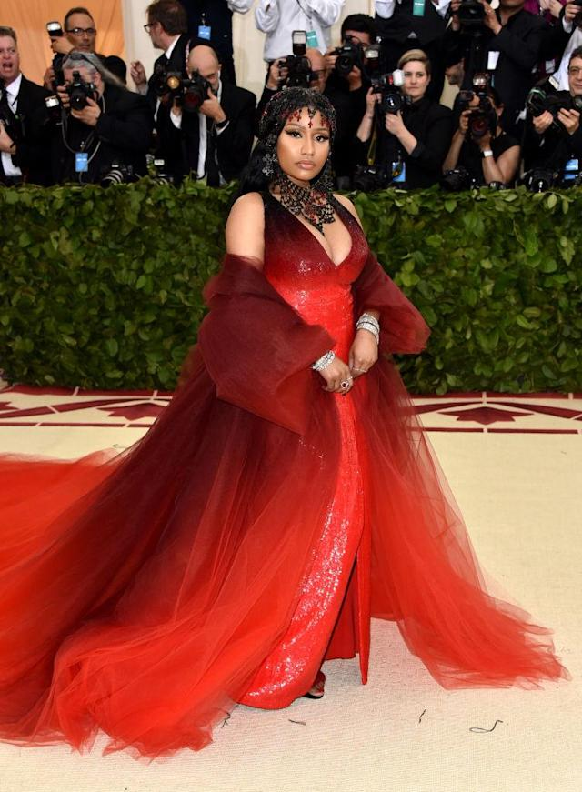 <p>Minaj's red and black Oscar de la Renta ensemble brought her to the dark side. (Photo: Getty Images) </p>