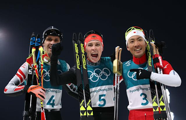 Nordic Combined Events - Pyeongchang 2018 Winter Olympics – Men's Individual 10km Final – Alpensia Cross-Country Skiing Centre - Pyeongchang, South Korea – February 14, 2018. Lukas Klapfer of Austria, Eric Frenzel of Germany and Akito Watabe of Japan celebrate after the finish line. REUTERS/Carlos Barria