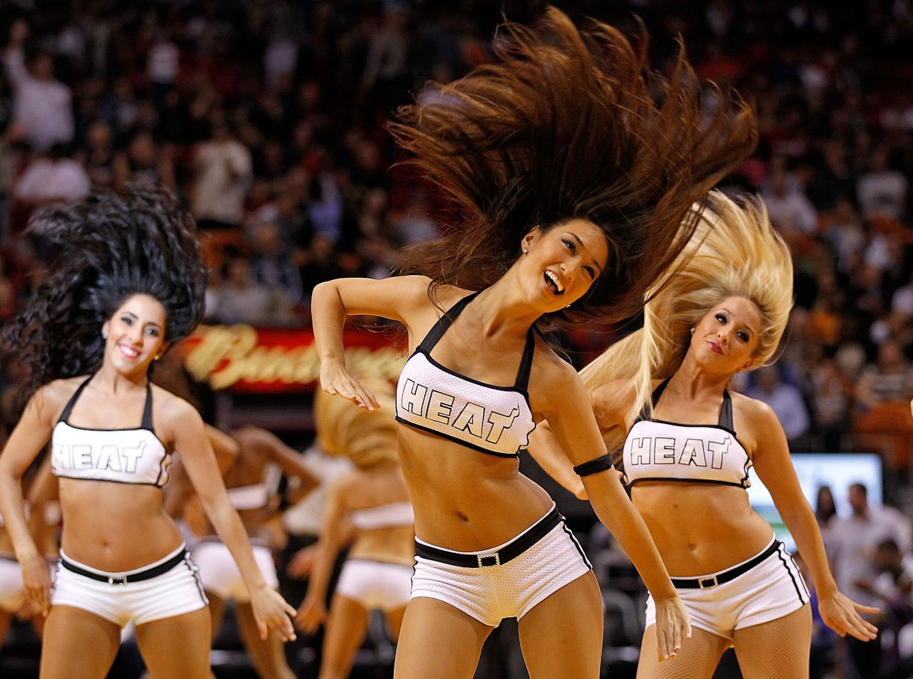 MIAMI, FL - JANUARY 21: The Miami Heat dancers perform during a game against the Philadelphia 76ers at American Airlines Arena on January 21, 2012 in Miami, Florida. NOTE TO USER: User expressly acknowledges and agrees that, by downloading and/or using this Photograph, User is consenting to the terms and conditions of the Getty Images License Agreement.  (Photo by Mike Ehrmann/Getty Images)