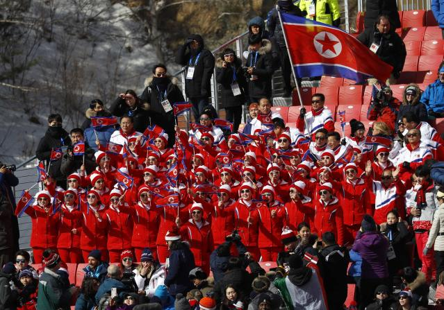 Alpine Skiing - Pyeongchang 2018 Winter Olympics - Men's Giant Slalom - Yongpyong Alpine Centre - Pyeongchang, South Korea - February 18, 2018 - North Korean cheerleaders react. REUTERS/Leonhard Foeger