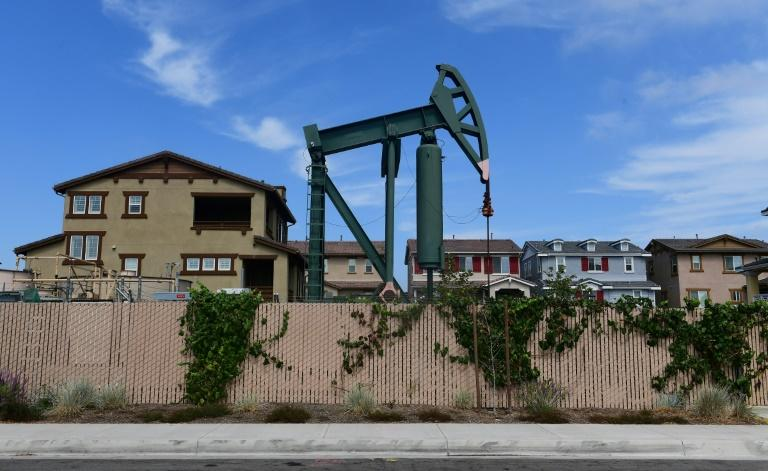 A pumpjack stands out among homes in residential Signal Hill, south of Los Angeles, California