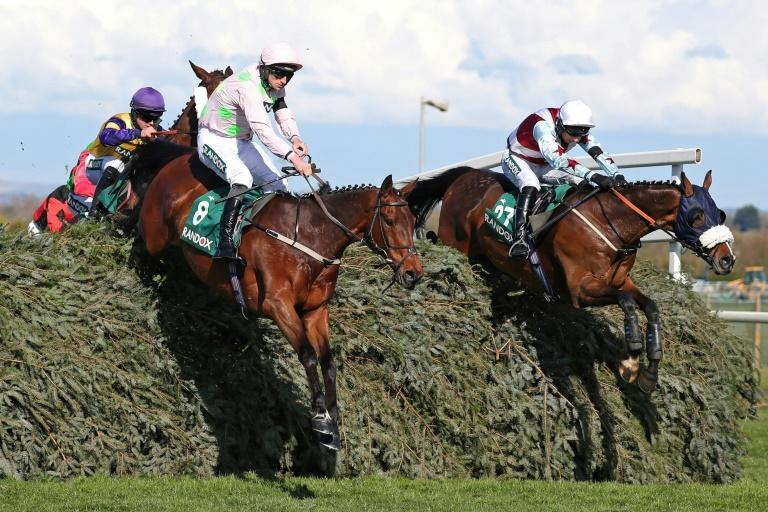 Patrick Mullins warmed up for the Grand National with a thrilling front-running winning ride on Livelovelaugh (left)