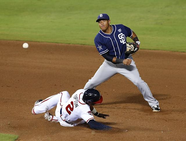 ATLANTA, GA - JULY 25: Second baseman Yangervis Solarte #27 San Diego Padres throws to first base while centerfielder B.J. Upton #2 of the Atlanta Braves slides into second during the game at Turner Field on July 25, 2014 in Atlanta, Georgia. (Photo by Mike Zarrilli/Getty Images)