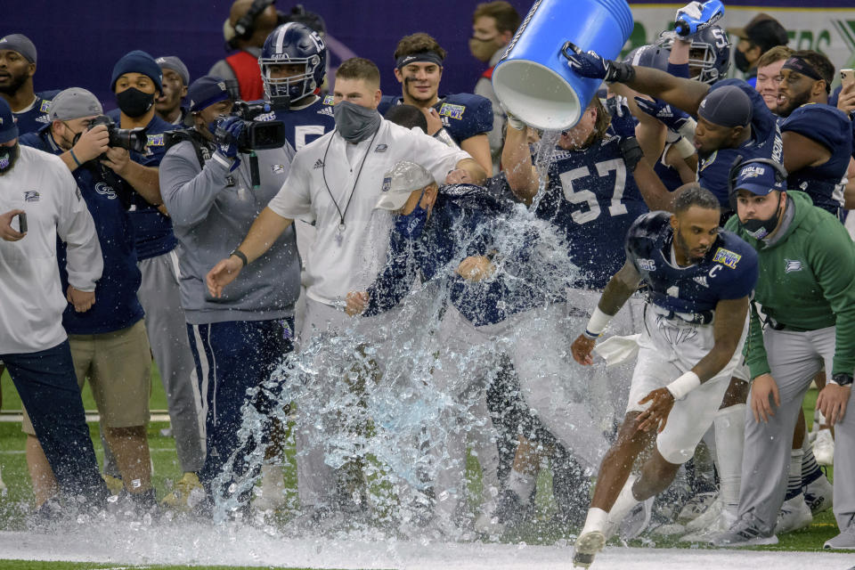 Georgia Southern head coach Chad Lunsford gets doused as his team starts to celebrate a victory over Louisiana Tech in the New Orleans Bowl NCAA college football game in New Orleans, Wednesday, Dec. 23, 2020. (AP Photo/Matthew Hinton)
