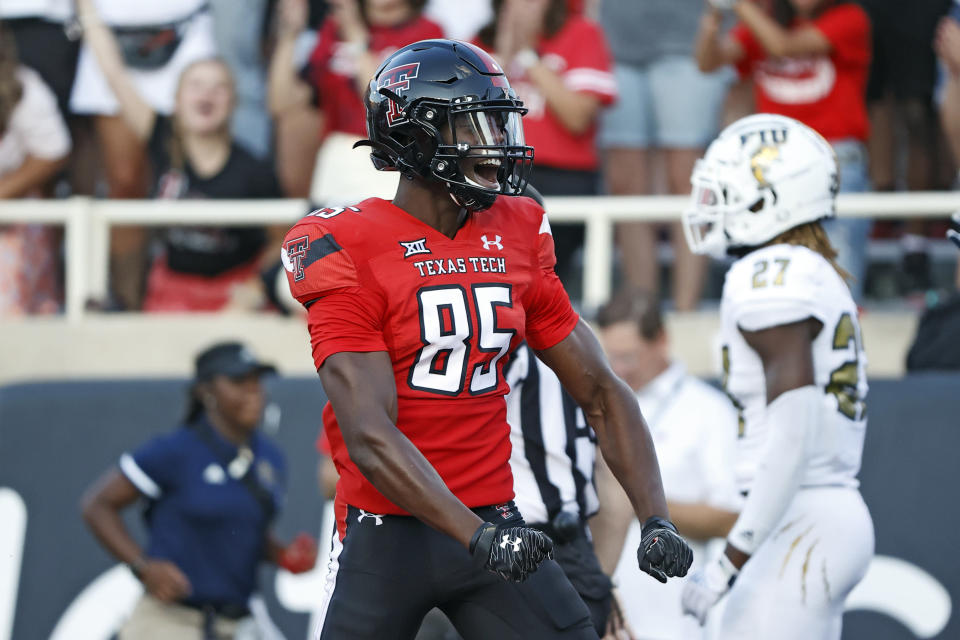 Texas Tech's Trey Cleveland (85) yells after scoring a touchdown during the second half of an NCAA college football game against Florida International, Saturday, Sept. 18, 2021, in Lubbock, Texas. (AP Photo/Brad Tollefson)