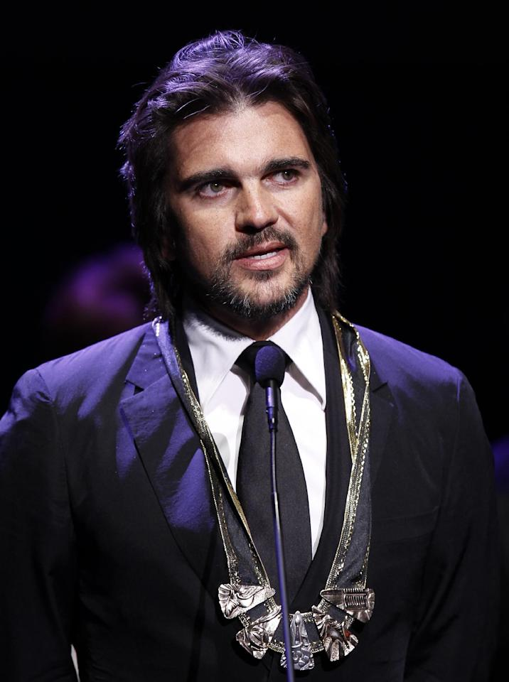 Juanes delivers a speech after receiving the Vision award at the 25th Annual Hispanic Heritage Awards, Thursday, Sept. 15, 2011, in Washington.(AP Photo/Luis M. Alvarez)