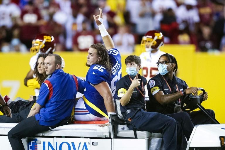 Nick Gates of the New York Giants is taken from the field after suffering a broken leg in the first quarter of the team's 30-29 NFL loss to the Washington Football Team (AFP/Rob Carr)