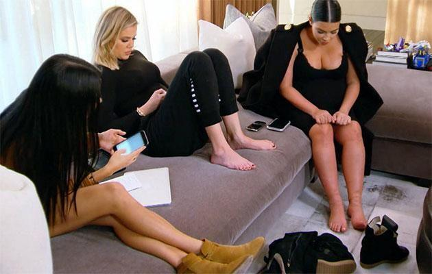 Kim struggled taking off her shoes while pregnant. Source: E!