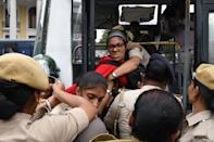 Police arrest a protester at the Town Hall during a demonstration held against India's new citizenship law in spite of a curfew in Bangalore on December 19, 2019. - Indians defied bans on assembly on December 19 in cities nationwide as anger swells against a citizenship law seen as discriminatory against Muslims, following days of protests, clashes and riots that have left six dead. (Photo by Manjunath Kiran / AFP) (Photo by MANJUNATH KIRAN/AFP via Getty Images)