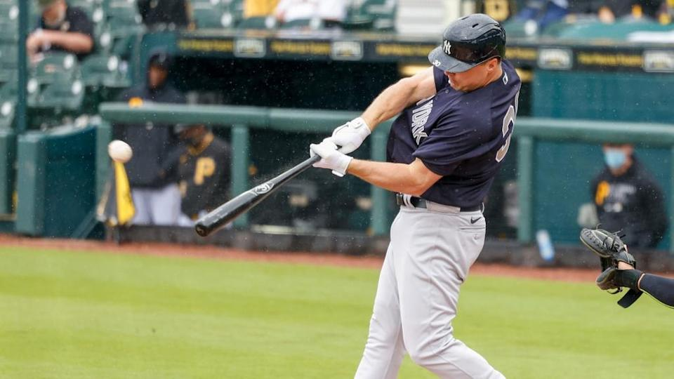 Mar 6, 2021; Bradenton, Florida, USA; New York Yankees right fielder Jay Bruce (30) hits a home run in the top of the first inning during spring training at LECOM Park.