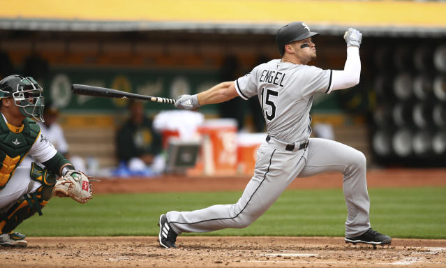 Chicago White Sox's Adam Engel swings for an RBI single off Oakland Athletics pitcher Andrew Triggs during the second inning of a baseball game Wednesday, April 18, 2018, in Oakland, Calif. (AP Photo/Ben Margot)