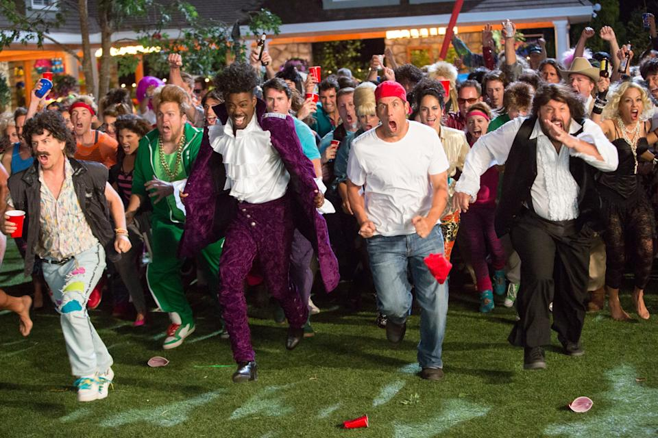 GROWN UPS 2, David Spade (left, vest), Chris Rock (in purple), Adam Sandler (red cap), Kevin James (front right), Maria Bello (right, blonde hair), 2013. ph: Tracy Bennett/©Columbia Pictures/courtesy Everett Collection