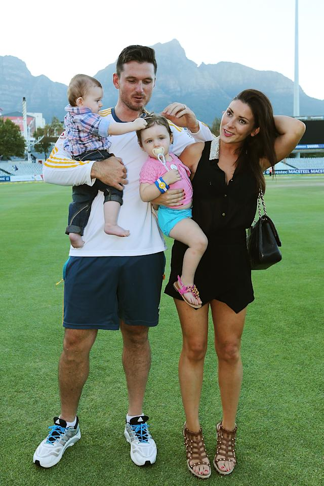 CAPE TOWN, SOUTH AFRICA - MARCH 05:  Graeme Smith of South Africa stands with his wife Morgan Deane and children Cadence and Carter after the match during day 5 of the third test match between South Africa and Australia at Sahara Park Newlands on March 5, 2014 in Cape Town, South Africa.  (Photo by Morne de Klerk/Getty Images)