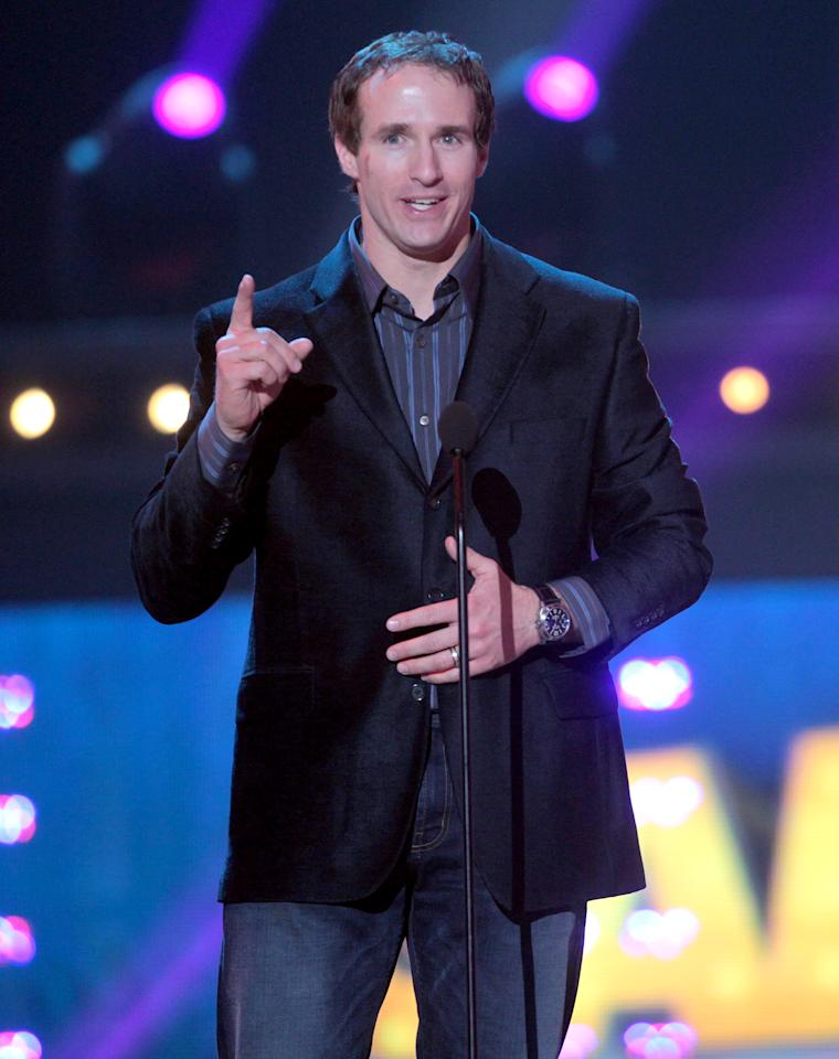 SANTA MONICA, CA - FEBRUARY 18: NFL player Drew Brees speaks during the 2nd Annual Cartoon Network Hall of Game Awards at the Barker Hangar, Santa Monica Airport on February 18, 2012 in Santa Monica, California.  (Photo by Frederick M. Brown/Getty Images)