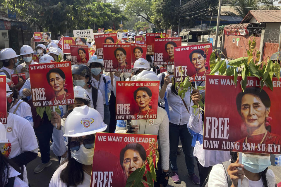 """FILE - In this March 5, 2021, file photo, protesters hold portraits of deposed Myanmar leader Aung San Suu Kyi during an anti-coup demonstration in Mandalay, Myanmar. U.N. Secretary-General Antonio Guterres bracketed Myanmar with Afghanistan and Ethiopia as nations for whose people """"peace and stability remain a distant dream"""" in a speech last Tuesday, Sept. 21, 2021, to open the annual U.N. General Assembly. (AP Photo/File)"""